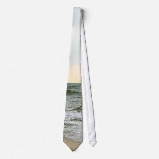 Boats in the sea and waves in the border of the tie