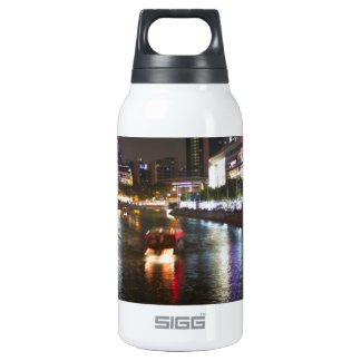 Boats making way down the river in Clarke Quay 10 Oz Insulated SIGG Thermos Water Bottle