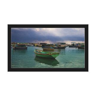 Boats of fishing village Marsaxlokk on Malta Canvas Print