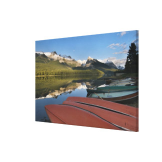 Boats parked on the lakeshore of Maligne Lake, Canvas Print