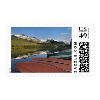 Boats parked on the lakeshore of Maligne Lake, Stamps