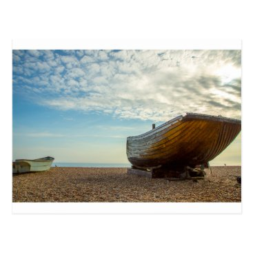 Beach Themed Boats, pebbles and late summer sun postcard