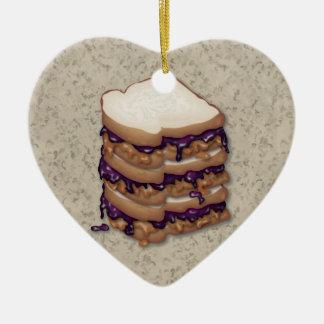Bocadillos de la mantequilla y de la jalea de adorno navideño de cerámica en forma de corazón