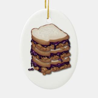 Bocadillos de la mantequilla y de la jalea de adorno navideño ovalado de cerámica