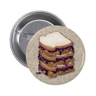 Bocadillos de la mantequilla y de la jalea de caca pin redondo de 2 pulgadas