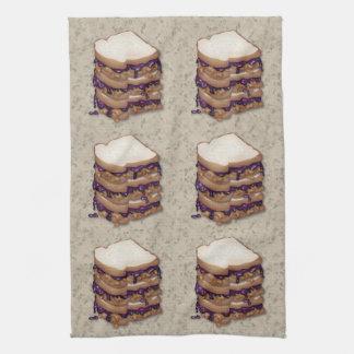 Bocadillos de la mantequilla y de la jalea de caca toalla de cocina