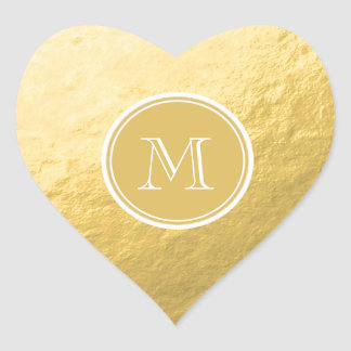 Boda del monograma del fondo de la hoja de oro del pegatina en forma de corazón