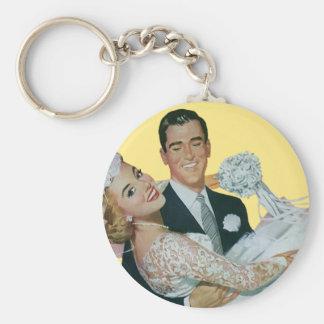 Boda del vintage novia que lleva del novio recie llavero