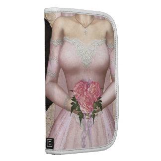 Boda rosado de novia y del novio planificadores