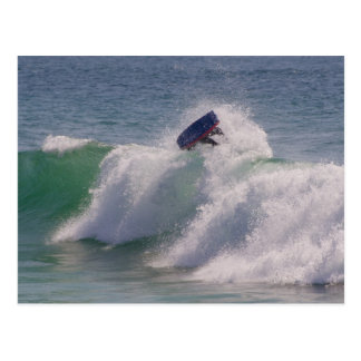 Body boarder riding a big wave postcard