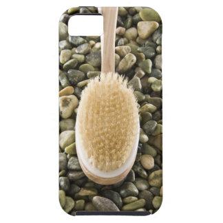 Body scrub brush on rocks iPhone SE/5/5s case
