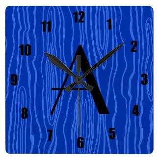 Bois azules del monograma falsos reloj de pared