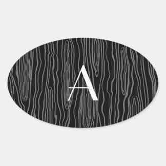 Bois negros del monograma falsos pegatina óval