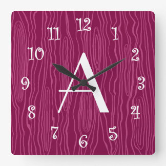 Bois púrpuras del ciruelo del monograma falsos relojes de pared