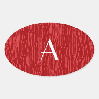 Bois rojos del monograma falsos pegatina ovalada
