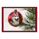 Bola colgante de la tarjeta de Navidad del husky s