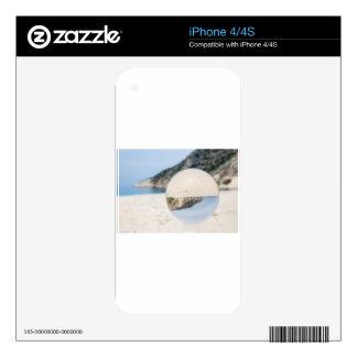 Bola de cristal en la playa griega arenosa skins para eliPhone 4