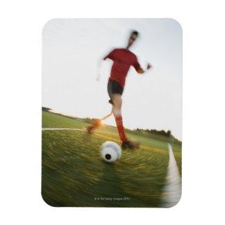 Bola de goteo del jugador de fútbol iman