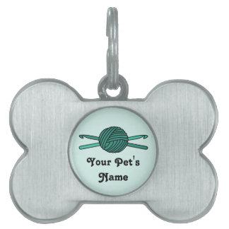 Bola de la turquesa de los ganchos del hilado y de placa de nombre de mascota