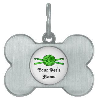 Bola de la verde lima de los ganchos del hilado y  placa mascota
