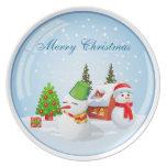 Bola de nieve del navidad con el muñeco de nieve y platos