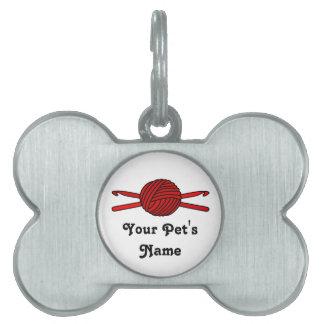 Bola roja de los ganchos del hilado y de ganchillo placa mascota