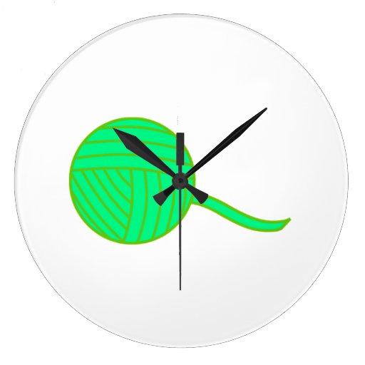 Bola verde del hilado reloj de pared