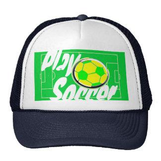 Bola y campo de fútbol del juego gorras
