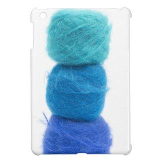 bolas apiladas del hilado azul