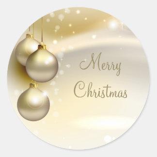 Bolas del navidad del oro en el oro pegatina redonda