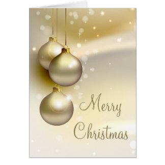 Bolas del navidad del oro en el oro tarjeta de felicitación