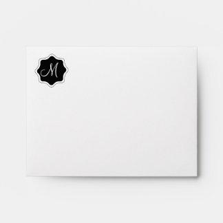 bold black and white quatrefoil envelope