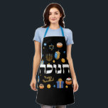 """Bold Bright Classy Hebrew Hanukkah Menorah Dreidel Apron<br><div class=""""desc"""">Set a Happy Hanukkah tone with this Bold & Bright Hanukkah Apron. Sure to make someone smile . It is the perfect way wish friends and family a Happy Hanukkah. Whimsical colorful Chanukah elements — including Jelly Donuts, Dreidels, Wrapped Gifts, Gold Coins and Stars of David— surround the word CHANUKAH...</div>"""