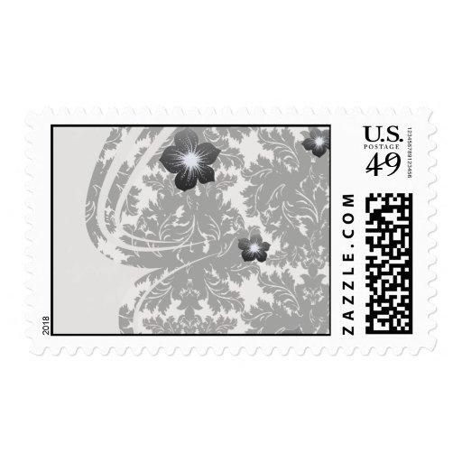 bold intricate black damask on white postage stamp