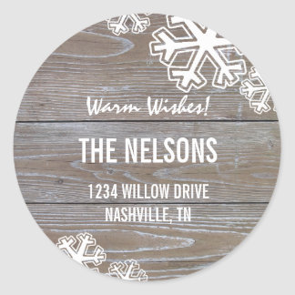 Bold Snowflakes on a wooden Background Classic Round Sticker