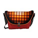 Bolso anaranjado de la rejilla que brilla intensam bolsas de mensajería