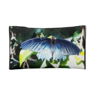 Bolso azul del cosmético de la mariposa