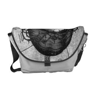 Bolso blanco y negro del icono bolsas messenger