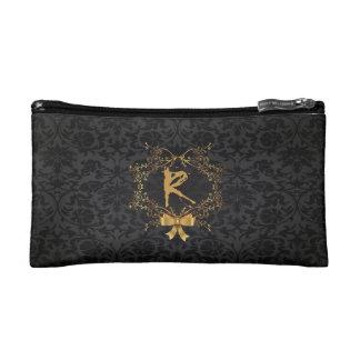 Bolso cosmético con monograma de oro de lujo