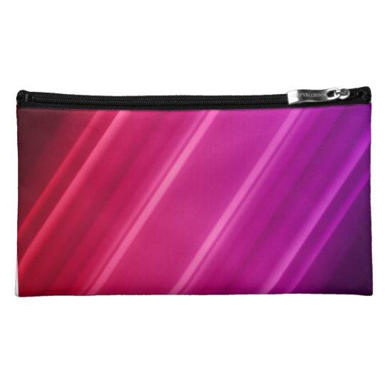 Bolso cosmético rosado y púrpura
