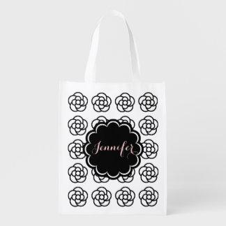 Bolso de ultramarinos blanco de la camelia con nom bolsas para la compra