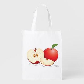 Bolso de ultramarinos rojo cortado de las manzanas bolsa para la compra