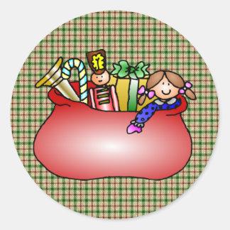 bolso del juguete de santa pegatina redonda