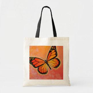 Bolso del monarca que agita bolsa de mano