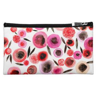 Bolso negro y rojo del cosmético de las flores