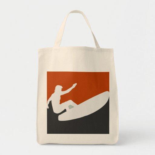 Bolso que practica surf bolsas de mano
