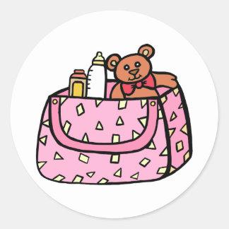 bolso rosado del bebé pegatina redonda