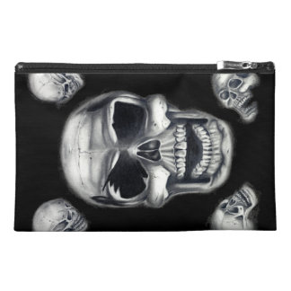 Bolsos accesorios negros de los cráneos humanos