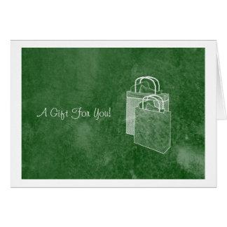 Bolsos de compras verdes dinero o tarjeta de regal