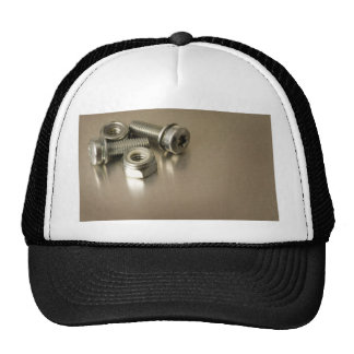 Bolts and nuts on metal surface trucker hat